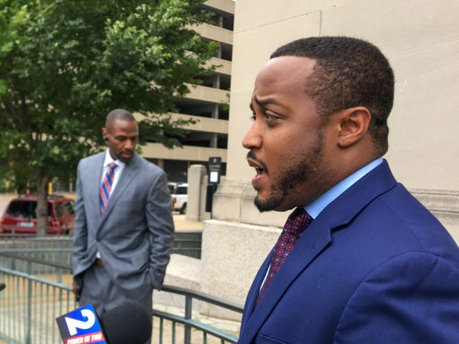 Daniel Dailey, attorney for William Tisaby, spoke to the media after a hearing on June 24. Jermaine Wooten (left), also a defense attorney in the case, listens in Photo by Rebecca Rivas/Missouri Independent