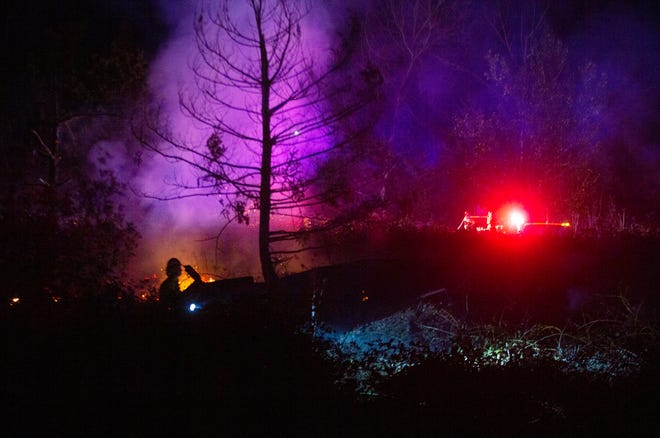 A South Lane Fire District fire crew battles a brush fire in Creswell that began within 100 feet of the city fireworks show at the old Bald Knob Mill site along Interstate 5. Firefighters were dispatched at 10 p.m. and extinguished the fire by 2:30 a.m.