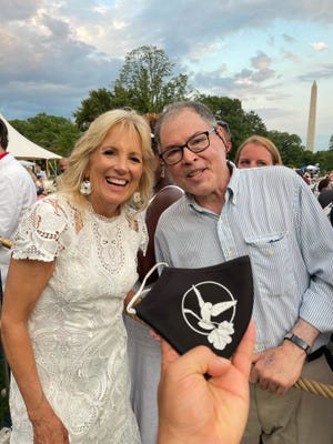 White Bird Clinic Executive Coordinator Chris Hecht meets First Lady Jill Biden at an Independence Day event at the White House celebrating progress on fighting the COVID-19 pandemic.