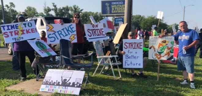 Striking Frito-Lay plant employees displayed signs Monday morning while picketing east of the plant, at the southeast corner of S.W. 42nd and Topeka Boulevard.