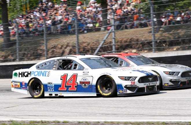 Mitchell's Chase Briscoe (14) duels side-by-side with Brad Keselowski Sunday in the NASCAR Cup Series' Jockey Made in America 250 at Road America in Elkhart Lake, WI.   (HHP/Harold Hinson)