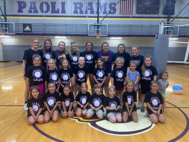 A group of campers and high school players pose in the lower gym at Paoli High School.