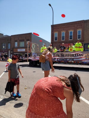 Frisbees were tossed to the crowd during Sunday's July 4 parade in Watertown. The parade capped the weekend celebration. There was a public fireworks display Saturday night.