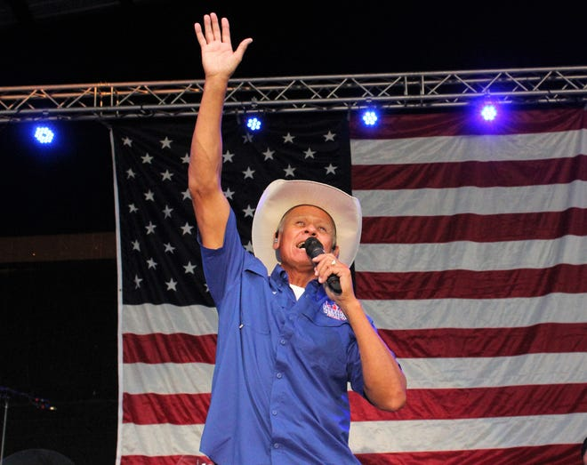 Country singer Neal McCoy waves howdy to fans in Abilene who gathered at the pavilion at the Taylor County Expo Center to celebrate the Fourth of July. Before he sang, he led the Pledge of Allegiance on stage, joined by a Dyess Air Force Base color guard.