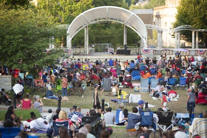 People gathered at Pack Square Park in downtown Asheville ahead of the city's Fourth of July fireworks July 4, 2021. Some residents are upset about the illegal fireworks, exploded by individuals, that continued well into the night and throughout the weekend.