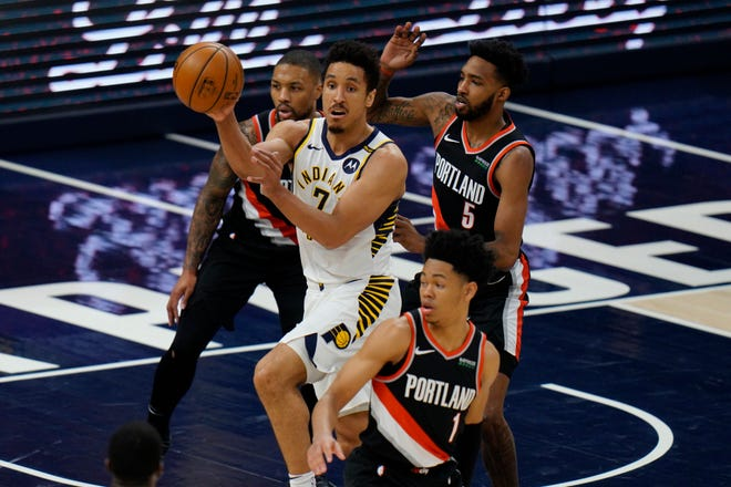 Indiana Pacers guard Malcolm Brogdon (7) in action as the Portland Trail Blazers played the Indiana Pacers in an NBA basketball game in Indianapolis, Tuesday, April 27, 2021. (AP Photo/AJ Mast)