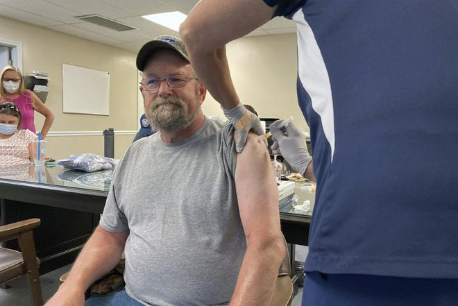 """John Rogers receives a second dose of the COVID-19 vaccine in Spencer County, Ky., on  June 17, 2021. Rogers waited months after becoming eligible for the COVID-19 vaccine. It was only after talking with friends that the retiree was persuaded to get the shot. """"They said, 'You know, the vaccine may not be 100%, but if you get COVID, you're in bad shape,'"""" Rogers said. """"You can die from it."""""""