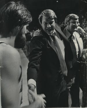 Coach Don Nelson was a proud and happy man after the Bucks had beaten the Phoenix Suns to sweep their playoff series. Nelson, his arm around assistant coach John Killilea, congratulated guard Brian Winters with a handshake.