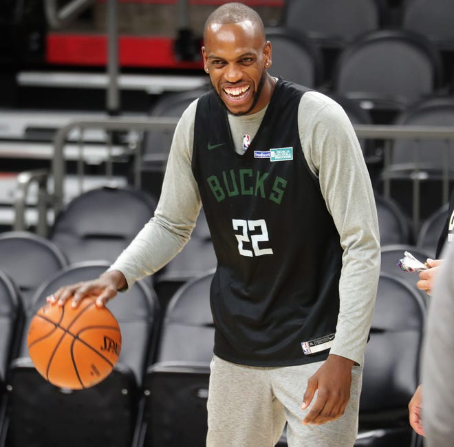 Bucks forward Khris Middleton has a laugh during a practice session. ESPN's Jalen Rose expects a better game from Middleton tonight.