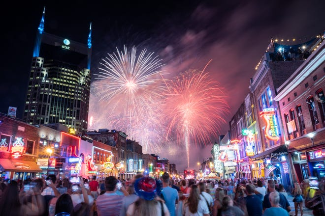 Fireworks light up the sky over Broadway during Let Freedom Sing!  July 4 Music City event in Nashville, Tennessee on Sunday July 4, 2021.