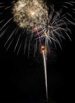Apache Junction's Fourth of July fireworks light up the sky over Apache Junction High School on July 4, 2021.