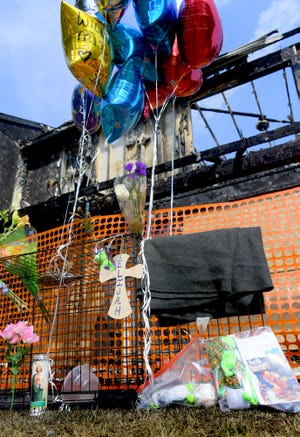 A memorial stands at 1567 Poplar Terrace in West York, Monday, July 5, 2021. A fire at the home on Saturday claimed the life of Elijah Hawkins, 8. Bill Kalina photo