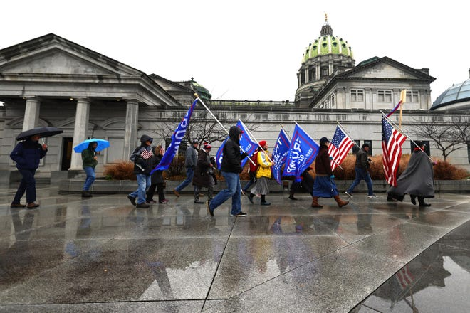 Supporters of President Donald Trump gather outside the Pennsylvania State Capitol on December 14, 2020 in Harrisburg, Pennsylvania. (Michael M. Santiago/Getty Images/TNS)