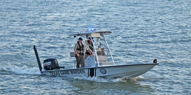 Texas Game Wardens with Texas Parks and Wildlife patrol the waters of Lake Nasworthy on Sunday, July 4, 2021.