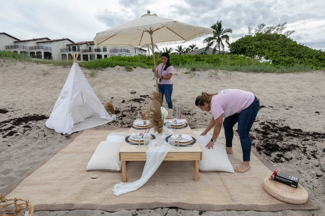 """Best friends Arely Pinon and Ilse Tiffany, of Fort Pierce, recently started a their luxury picnic company, Live Love Picnic. """"We just like to make really nice memories,"""" said Pinon after setting up a surprise anniversary picnic at Glascock Beach in Jensen Beach on Saturday, July 3, 2021."""