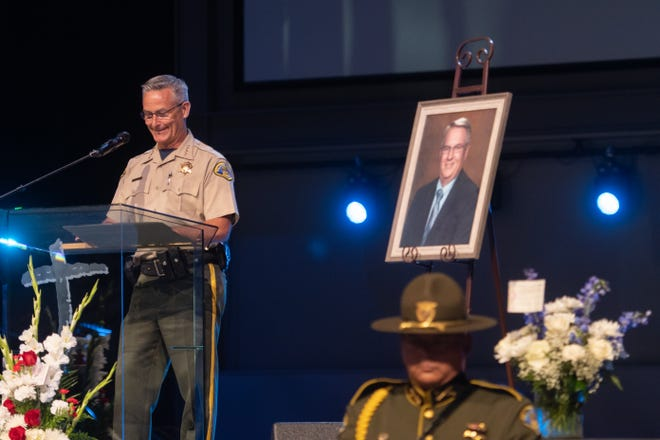 Tulare County Sheriff Mike Boudreaux shares memories of Phil Cox, who died of cancer last month, at a Saturday memorial service.