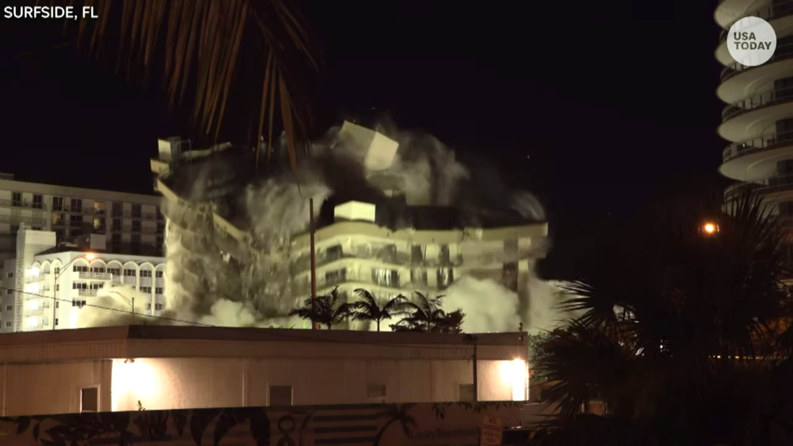 Controlled explosions as demolition crews blast what s left of collapsed Florida condo