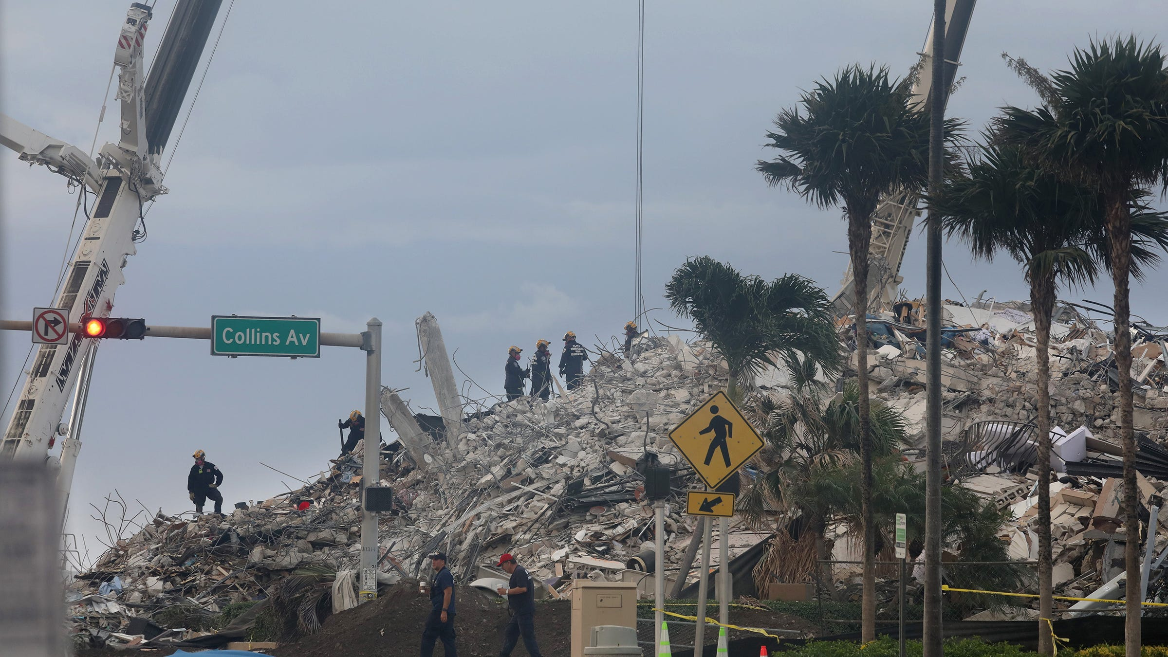 Search and rescue crews work on top of the rubble of the Champlain Towers South condo in Surfside, Florida July 5, 2021 after the remaining portions of the collapsed condo was leveled by controlled implosion Sunday night.