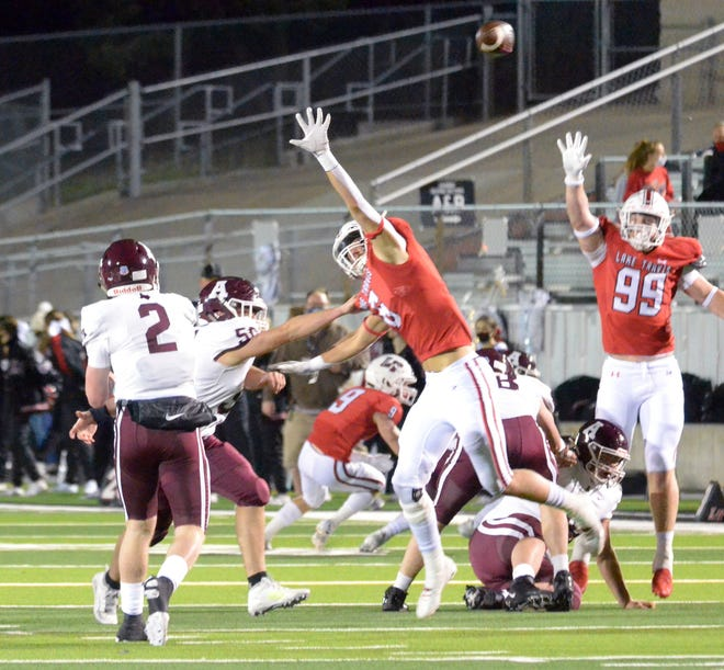 Lake Travis defensive end Trey Dorsett pressures Austin High quarterback Charles Wright in a game last season. Dorsett and fellow defensive end Max Linhoff each earned second-team, all-district recognition a year ago while combining for 41 tackles and five tackles for a loss