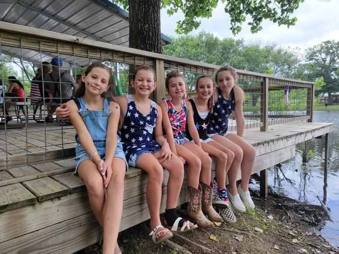 Kannin Bartsch, Colbie Beniot, Lainey King, Callie Jo Beniot and Belle Bartsch show their patriotic spirit at Vincent Goertz's July 4 party.