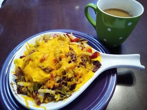 A skillet with scrambled eggs, crispy bacon, sautéed onions, sautéed peppers and cheddar cheese is served at Magic City's Remarkable Diner in Barberton.