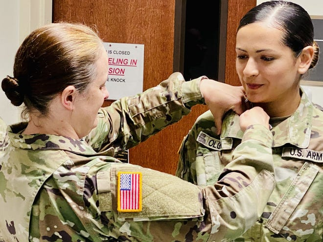 Staff Sgt. Heather Adkins, pathology non-commissioned officer-in-charge and phase two student coordinator for Bayne-Jones Army Community Hospital, pins the U.S. Army Medical Department crest on Pfc. Victoria Olguin during her military medical laboratory technician graduation at the Joint Readiness Training Center and Fort Polk, La. on July 1.