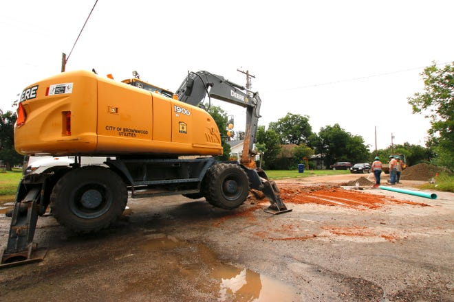 Employees with the City of Brownwood's utilities department install sewer line Tuesday near the intersection of Second Street and Avenue J. The new sewer line is in connection with the future construction of a Food Plaza convenience store at Austin and Coggin avenues. The city earlier approved a grant and infrastructure incentive to DiL Petroleum, which plans to build the store and develop a multi-tenant retail space.