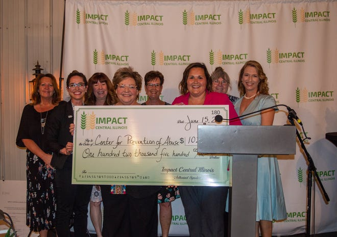 Pictured are members of the organization, Center for Prevention of Abuse, accepting their award of $102,500.