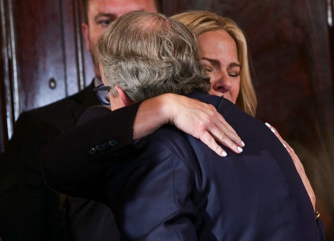 """Kathleen Wiant, mother of Collin Wiant, embraces Ohio Gov. Mike DeWine on Tuesday after he signed Ohio's Anti-Hazing Act at the Statehouse in Columbus. The bill is also known as """"Collin's Law"""" after Collin Wiant, who died during a hazing incident in 2018 as a freshman at Ohio University."""