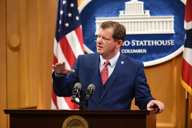 State Rep. Jason Stephens answers questions during a press conference. He is sponsoring a bill that would adjust the homestead tax exemption for inflation.