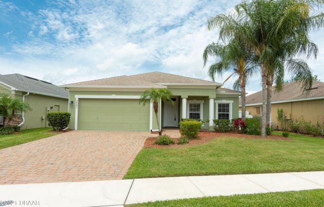 This meticulously maintained, move-in-ready, four-bedroom, three-bathroom home is in the heart of Port Orange.