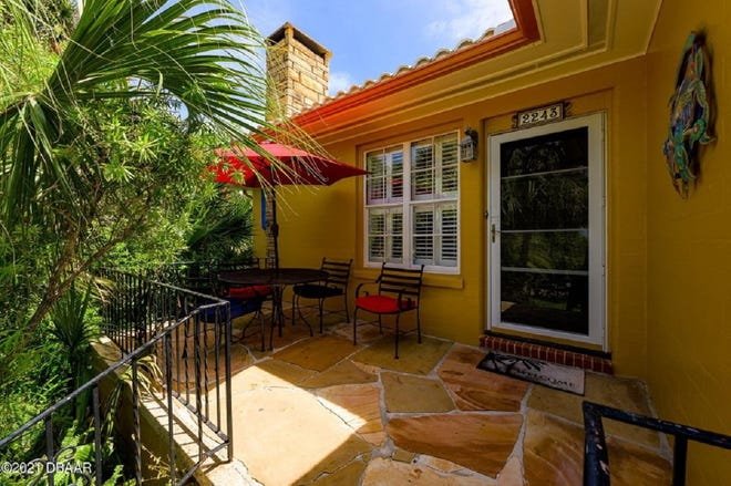 Built on three lots on the highest natural elevation in Daytona Beach, this property has a main house that has been turned into two separate residences, and a former garage that has been turned into a classic one-bedroom, one-bath ''Hemingway cottage.''