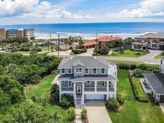 Situated between the white-sand shores of the Atlantic Ocean and the Intracoastal Waterway in the Ponce Inlet beachside community of Las Olas, this beautiful pool home offers elevator access to all three floors as well as great ocean and lighthouse views from its nearly 1,200 square feet of balconies.