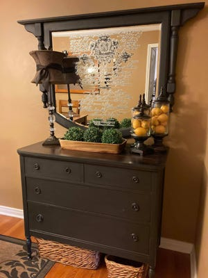Michelle Hannold, 46, a Wesleyville resident and owner of Purposely Repurposed by Michelle, a furniture and home-décor repurposing business, converted this roadside trash into a buffet. The mirror, which was intended for a dresser, was painted to match the buffet then flipped upside down so the top became a shelf.