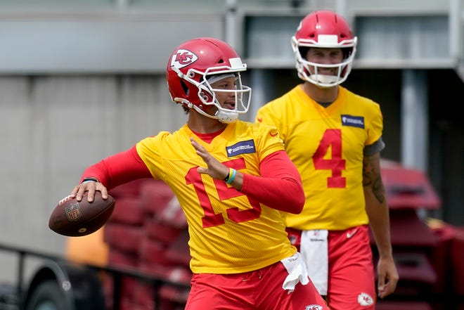 Kansas City Chiefs quarterback Patrick Mahomes (15) throws while teammate Chad Henne waits his turn during a minicamp practice in June. Mahomes is teaming with USA Football to hold three youth football coaching clinics this summer.