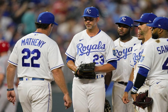 Kansas City Royals manager Mike Matheny (22) walks to the mound to replace starting pitcher Mike Minor (23) during the seventh inning of Monday's game against the Cincinnati Reds at Kauffman Stadium. Despite what Matheny called the best start of the season by Minor, the Royals lost 6-2.