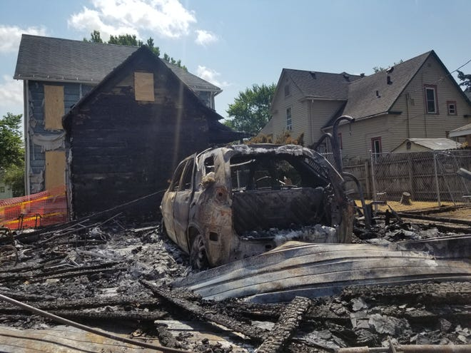 """A fire being investigated as """"suspicious"""" damaged a Burlington home and several nearby garages on Monday, July 5, 2021."""