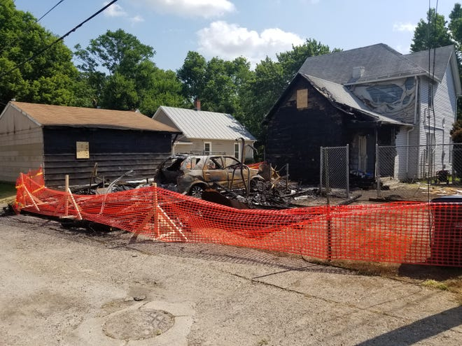 """A fire being investigated as """"suspicious"""" damaged a Burlington home and several nearby garages early Monday along Highland Avenue in Burlington."""