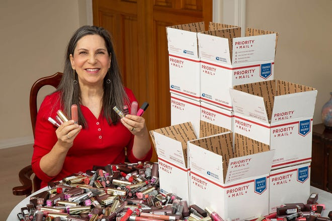 Sheryl Kurland shows some of the lipsticks she and her nonprofit, Find Your Fabulosity,collect and donate to domestic-violence survivors.