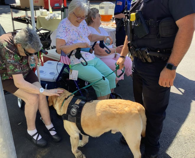 Annette Bastarache, left, Impi Sylvester and Theresa Jaillet meet with Westminster Police Department K9 Merle during a recent Coffee with a Cop event at Heywood Wakefield Commons in Gardner.