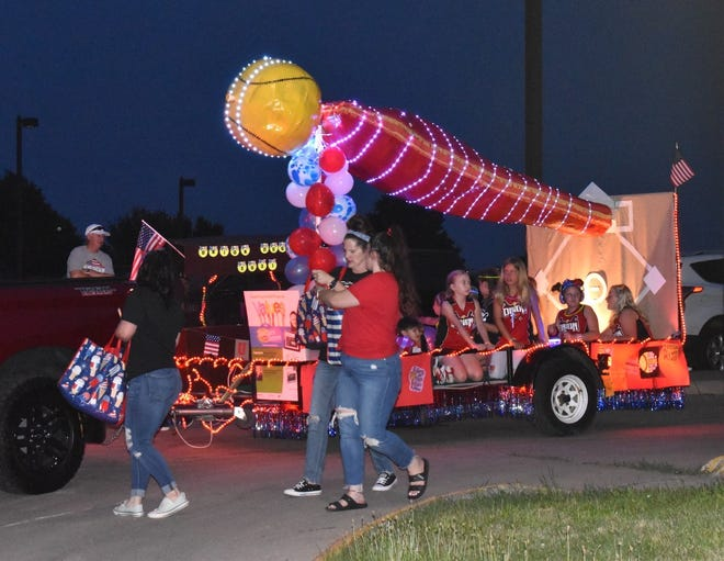 Orion Little League softball players won the award for best children's entry in the Orion Fireworks Festival's lighted parade on Saturday, July 3.