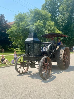 A 1916 Rumley chugs it's way past  Wiley Park in the Galva Freedom Fest parade.