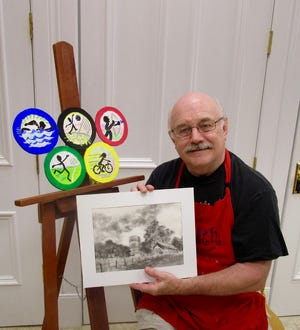 David Smith, owner/operator of Smith Studio and Gallery in downtown Geneseo, holds a reverse pencil drawing which will be the subject of one of the upcoming Children's Summer Art Classes. The Olympic Painting, on the easel, also will be the subject of one of the children's summer classes.