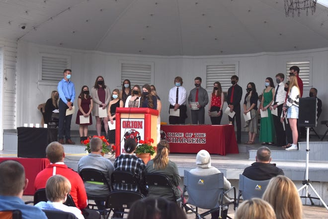 New members of Orion High School's chapter of the National Honor Society were inducted on Wednesday, May 12, in Central Park.