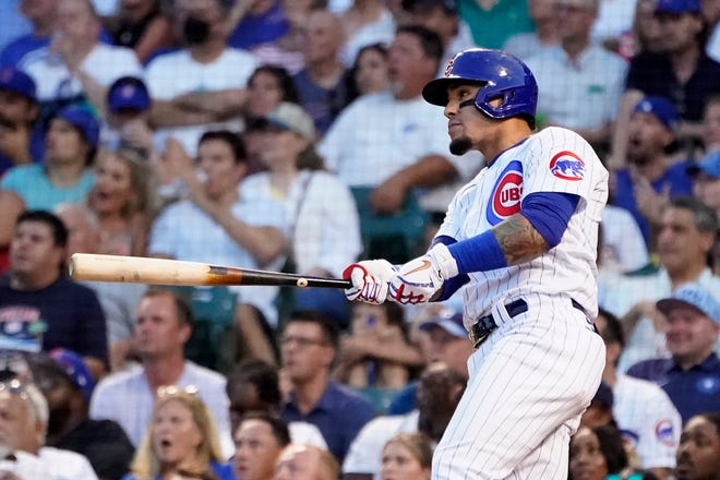 Chicago Cubs shortstop Javier Baez watches his RBI double off Philadelphia Phillies starting pitcher Matt Moore during the third inning of Monday's game in Chicago.