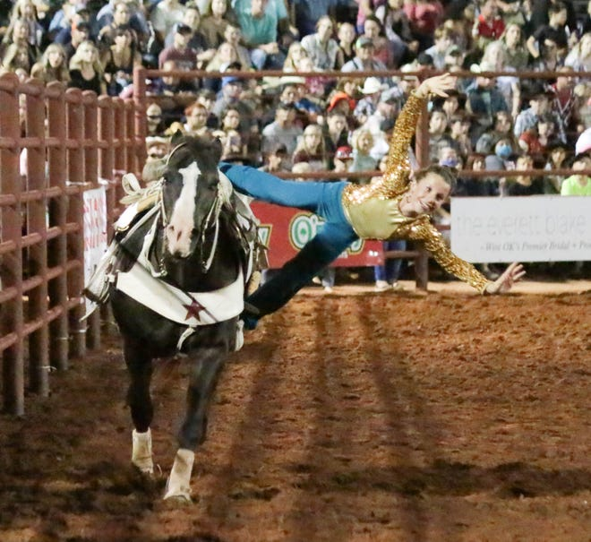 Shyla Navarre does the Stroud layout trick as she trick rides at a rodeo. The eldest daughter of Corey and Melissa Navarre, she and her younger sister, Layna, will entertain during the Phillipsburg rodeo August 5-7.
