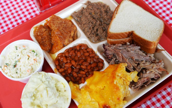 This is Midway BBQ in Buffalo: homemade Cole slaw, sweet potato casserole, beef hash, baked beans, mac and cheese, and pulled pork.