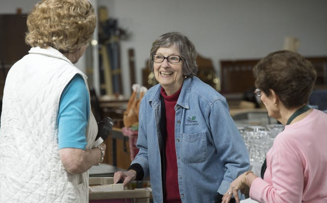 Gayle Cook, center, talks with Sue Bowman and Kathy McFall as they arrange donations for the Monroe County History Center's annual garage sale in 2017.