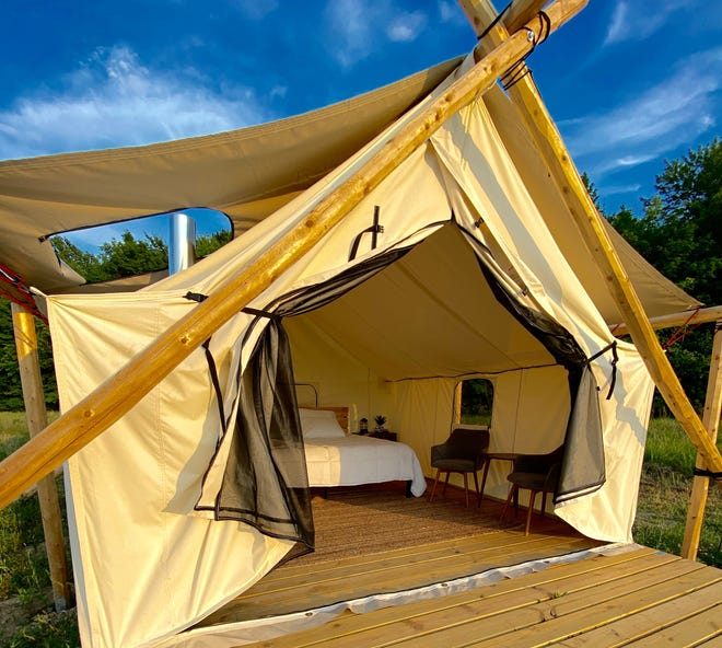 Each tent at Off Map comes with a king-size bed or three twin-size beds, a seating area, bedside tables, fans, lanterns and chargers.