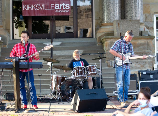 The Aaron Russell Band performs as part of the Summer on the Square Concert Series in front of the Adair County Courthouse.